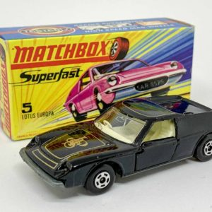 """Matchbox Superfast 5a Lotus Europa - black body with high arches & gold """"JPS"""" tampo print, clear windows, ivory interior, bare metal base with cast shut tow slot, 5-spoke wide wheels - Near Mint in Near Mint to Mint type I box without """"New""""."""