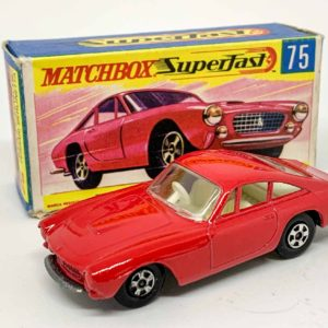 """Matchbox Superfast 75a Ferrari Berlinetta – red body without silver trim, clear windows, ivory interior, bare metal base, large diameter 5-spoke narrow wheels without tread pattern cast – Mint in Good Plus to Excellent """"New"""" type G box."""