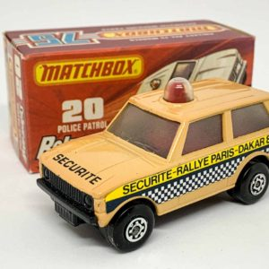 """Matchbox Superfast 20b Range Rover Police Patrol – metallic pearl desert sand body with """"Securite-Rallye Paris – Dakar 83"""" labels, """"Securite"""" hood tampo print, clear frosted windows, red spinner & roof light, gloss black base, Maltese Cross wheels – Excellent Plus with a couple of tiny chips in Excellent Plus type J box without """"New"""""""