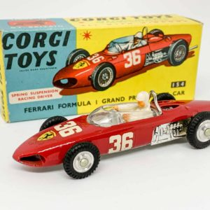 Corgi 154 Ferrari Formula 1 Grand Prix Racing Car - red body, silver interior with plastic figure driver, chrome engine, spun hubs, racing number 36 decals to sides and front - Near Mint a beautiful example in a Near Mint blue and yellow carded picture box